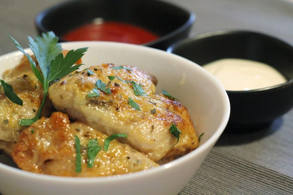 Alette con aglio e parmigiano cotte in Slow Cooker